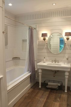 bathroom: whites, table vanity sink, sconces and mirror, planked walls, moldings...