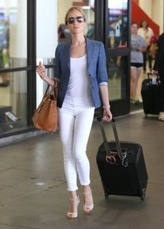 Kristin Cavallari Blazer - Kristin Cavallari chose a denim blazer to add some spice to her all-white travel look.