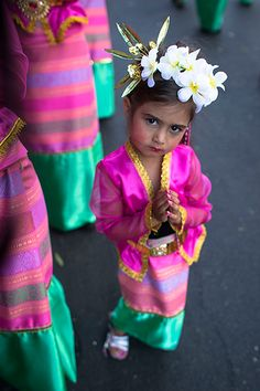 Berlin, Germany: A young girl dons a traditional Thai costume at the annual Carnival of Cultures parade