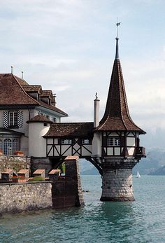 Oberhofen am Thunersee, Switzerland (by alainmichot93)   - Explore the World with Travel Nerd Nici, one Country at a Time. http://TravelNerdNici.com