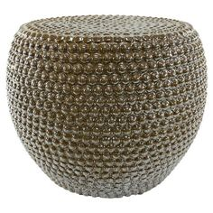 Add an artful touch to your vanity or breakfast nook with this eye-catching ceramic stool, showcasing a studded design and gold finish.