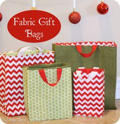 Fabric Gift Bag Tutorial- OOO this is a good idea for taking gifts to family. You can embroider each family's name and just keep the presents in the bag until you are ready to take them to the family!