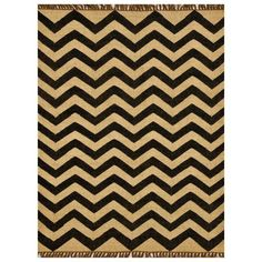 Hand-woven of wool and jute, this rug provides both resistance to wear and a natural, casual feel that is perfect for any room. This rug features a striking chevron stripe pattern in hues of beige jute and black wool.