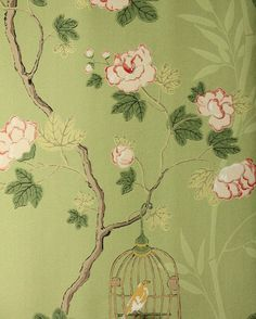 Songbird Wallpaper Climbing roses design with little birds in cages hanging from branches, in pink and cream on a green background.