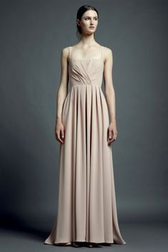 She looks like a porcelain doll. The nude hues from the dress is perfect -- Valentino Resort 2013