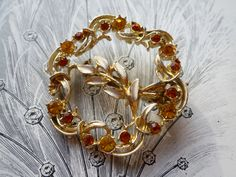 NOW SOLD! Vintage 1950s amber rhinestones circle brooch reduced price due to missing stone £4.50