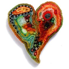 Large Papaya Heart by Meg Hannan.  I love the color combos in her work.  My lampwork beads need to be united with these works!