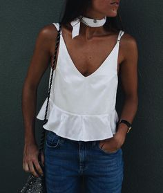 This spring, pair a white tank with a choker and jeans. Let Daily Dress Me help you find the perfect outfit for whatever the weather! dailydressme.com/