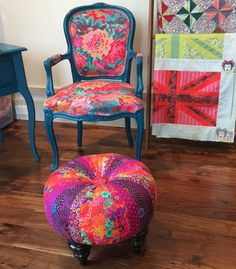 Eclectic fabric chair, possibly quilted fabric. Great choice for a bohemian style city loft. Home decorating. Up-cycled furniture, pretty apartment. Colorful furniture. Dining room chairs and ottomans.