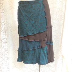 Here is a new upcycled cotton patchwork skirt that I just posted in my Etsy shop. Women Medium to Large in Teals and Dark Brown