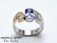 Purple sapphire and diamonds set in 14k two tone ring.