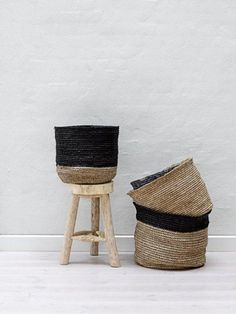 white walls, wood stool, baskets