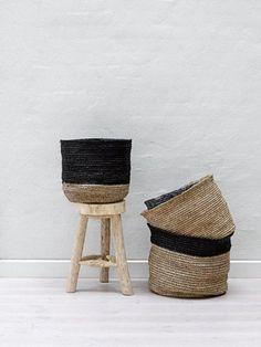 white walls, wood stool, baskets