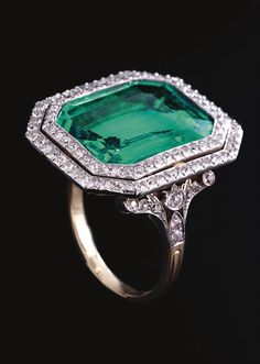 Very fine emerald and diamond ring. The step-cut emerald weighing approximately carats set within a double frame of circular-cut diamonds, highlighted by similarly-set shoulders, to a pierced scroll gallery Emerald Jewelry, Gems Jewelry, Art Deco Jewelry, Bling Jewelry, Jewelry Box, Jewelry Design, Jewellery, Emerald Rings, Antique Rings