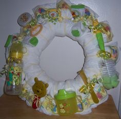 This is one Baby Shower Winnie The Pooh Diaper Wreath!   The wreath is made with the following items:  About 15 Pamper Swaddler diapers (Size1), PACIFIER, BOTTLE, BRUSH, COMB, WASH CLOTHS, (WASH, LOTION, POWDER, OINTMENT OR OTHER BABY CARE PRODUCTS), SOCKS, BOOTIES OR SHOES, GLOVES, HAT, TEETHER, TOYS, MEDICINE DISPENSER, BABY SCISSORS, BABY NAIL FILE, CLIPPERS, AND/OR ANY OTHER BABY RELATED ITEMS!   Unlike some other Wreaths, OURS come completely assembled and ready to use. Just take it...