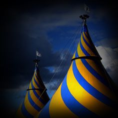 Perfect inspiration for the set, except in black and white | cirque du soleil travelling striped tents
