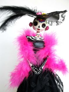 A very popular symbol of the Dia de los Muertos holiday in Mexico, is La Catrina... but I love to make Catrinas all year round. This Catrina is made