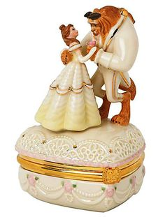 Beauty and the Beast Trinket Box  Relive the tale as old as time with our Beauty and the Beast Treasure Box by Lenox. An enchanting Beast and Belle sculpture is posed mid-waltz atop this romantic heart-shaped box. It's part of our collection of Lenox fine china treasure boxes that bring the Disney United States Postal Service Romance Stamps to life in 3-D miniatures. Inside the box you'll find a decal reproduction of the original stamp.