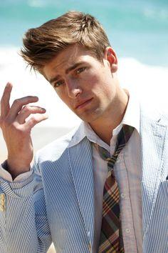 Pinstripe blazer and plaid tie