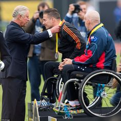 A royal award: Prince Charles, Prince of Wales presents a medal to a member of the Dutch c...