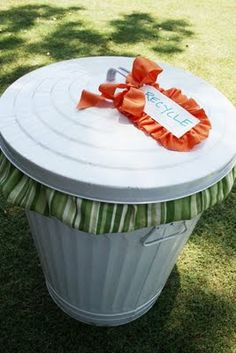 Cute painted metal trash can for recyclables. Great for a party instead of the old ugly ones.