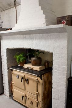 Fireplace and old stove.  Downstairs in Denmark Hill with Jo from Desire to Inspire | Walk Among The Homes