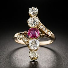 Victorian Ruby and Diamond Dinner Ring.  Just a smidgen shy of 1 inch long, striking and exceedingly lovely, this unique late-nineteenth century dinner ring centers on a bright vibrant red, half-carat Burmese ruby accompanied north and south by pairs of sparkling white old mine-cut diamonds, together weighing 1.50 carats. Small rose-cut diamonds glint from the bypass style shoulders