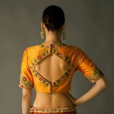This wedding season wear the trendy blouse designs with unique patterns. Blouse with stylish designs and latest designer blouse patterns of 2020 is every women's perfect addition to her saree for every occasion. Blouse Back Neck Designs, Pattu Saree Blouse Designs, Simple Blouse Designs, Stylish Blouse Design, Fancy Blouse Designs, Patch Work Blouse Designs, Sari Design, Blouse Designs Catalogue, Designer Blouse Patterns