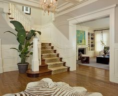 I wish I had a better website link for this foyer. I ran across this photo a couple years ago and I love everything about it except for the animal prints. Great coffered ceiling, hardwood floor, wood stairs with runner and wainscoting. I can totally envision a Christmas tree where the plant is next to the staircase. Perfect for my dream home! I imagine a coat closet under the stairs and French doors leading to the home office on the other side of the foyer.