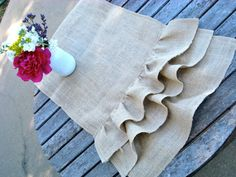 It's no secret that we love burlap table runners, but add in a ruffle and we're in heaven. For instance, this burlap table runner with ruffles is handmade by Just Kate Etc. and is brimming with rustic charm!