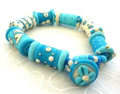 glass by Lush Lampwork, such a lovely colour!