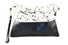 We can not get enough of this funky design. Splash is fun, splash is unique and looks sexy. Hand-painted black splatter on canvas paired with black vintage leather and an African fabric lining. Since the outside of the bag is already so much fun, getting a color burst when you open it will make your heart start to dance