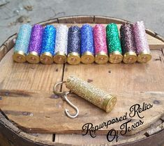 This up-cycled 12 gauge shotgun bullet casing is covered in glitter. It is sealed, so the glitter wont fall off. There is a 2 silver fish hook charm attached to the key ring. The ammo casing is 3 long. This is perfect for any country girl or mom that loves to hunt and fish. See more of my bullet jewelry on Etsy here: https://www.etsy.com/shop/RepurposedRelicsTX?section_id=16687149&ref=shopsection_leftnav_3   This keychain will ship within 1-2 business days. I ship using USPS First Class…