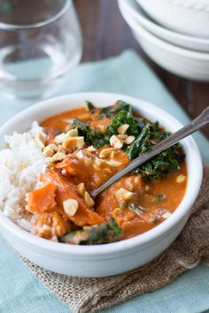 """vegan-yums: """" """"Thick sweet potato slabs are nestled in tender kale leaves and savory African peanut stew. Serve it up with rice and crunchy roasted peanuts for a hearty and delicious winter. Vegan Stew, Vegan Soups, Lunch Recipes, Soup Recipes, Cooking Recipes, Vegetarian Cooking, Vegetarian Recipes, Vegan Food, Peanut Stew Recipe"""
