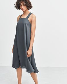 Silk dress cut from a more sustainable 100% double silk georgette that creates a soft and flowing drape. Wide straps crossed at the back and slits at the hem on both sides. Fully lined. Think twice before dry cleaning, hanging a dress outside to air is of
