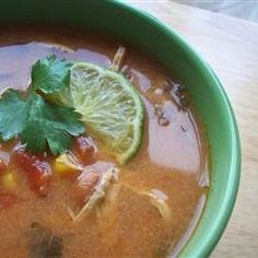 """""""This tortilla soup tastes better than anything you can get at a restaurant. And it's healthy too! Don't let the long list of ingredients fool you. All you do is dump everything into the slow cooker and walk away. Garnish with grated Cheddar, avocadoes, and a splash of fresh lime juice."""""""