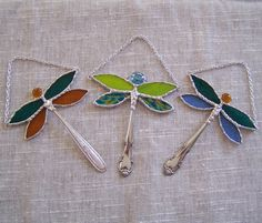 Stained Glass Dragonfly Suncatcher Ornament. This petite colorful dragonfly is a must. Available in your choice of colors. Decorative soldering adds lots of dimension to this piece. Vintage spoon handle for the body for a unique touch. A chain is added for hanging in your favorite window or on a wall. Measures approx. 4 x 5. Slight variations in spoon handle/body will occur. Listing is for one dragonfly in your choice of color.