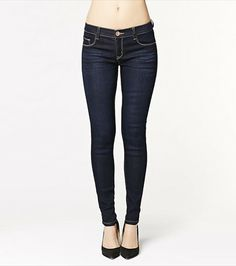 This dark wash skinny jegging looks fun and flirty paired with one of our graphic tees and a blazer.