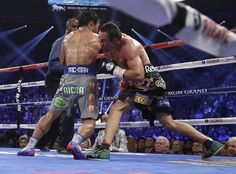 Juan Manuel Marquez, from Mexico, right, knocks out Manny Pacquiao, from the Philippines, in the sixth round of their WBO world welterweight fight