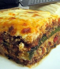 Moussaka- with zucchini instead of eggplant. my favorite dish. To bad we don't have food like that in cc. Moussaka- with zucchini instead of eggplant. my favorite dish. To bad we don't have food like that in cc. Eggplant Zucchini, Moussaka Recipe, Kolaci I Torte, Egyptian Food, Good Food, Yummy Food, Greek Cooking, Greek Dishes, Gratin