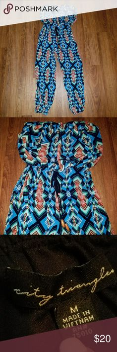 Geo Print jumper Geo Print jumpsuit playsuit City Triangles brand Size Medium  Elastic ankles Adjustable tie with wooden beads Blue green black tan maroon red white  Great used condition  No stains or tears Pet/smoke free home 15% off bundles of 3 or more Offers welcomed! City Triangles Pants Jumpsuits & Rompers