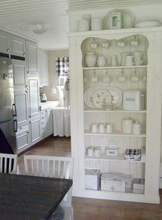 #French kitchen- use a cabinet like this- put a monster hinge on to hide a refrigerator behind!