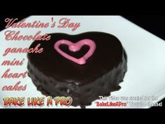 Valentine's Day Chocolate Ganache Mini Heart Cakes ! - Video Recipe    Let's make some really delicious mini Valentine's Day chocolate ganache cakes ! These tiny hearts are made with a deep, delicious chocolate cake base, then chocolate ganache is poured over them, I then add a hand crafted heart out of pink chocolate.  I show you all from start to finish, every single step, including making the chocolate ganache from scratch, an also how to make the little pin hearts out of chocolate.