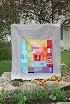 Divine rainbow log cabin quilt from Amanda Jean of Crazy Mom Quilts.