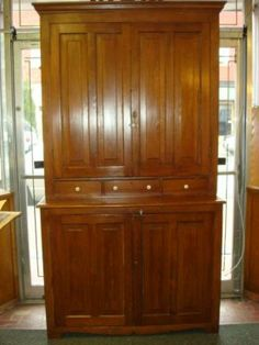 """Lot #663 (26th May, 14) - Live Auctioneers 19th C. STEP-BACK PINE CABINET: 2 Pieces; Upper Rectangular Section W/Flaring Molded Cornice Above Paneled Doors, Ceramic Knobs, 3 Small Side By Side Drawers. Set Back On Lower Case, Paneled Double Doors, Single Interior Shelf. Old Painted Interior. Modified Bracket Apron. 1-3 Interior Shelves. 90""""T x 49 1/2""""W x 201/2""""D (1800-3000)"""
