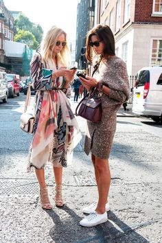 Fashion girls on their cellphones // street style, lifestyle
