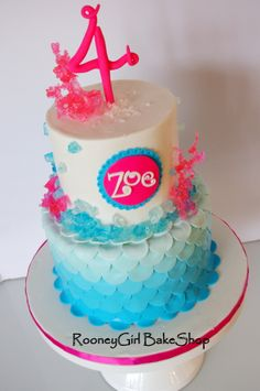 Totally digging the rock candy and color scheme of this pink and turquoise birthday cake.