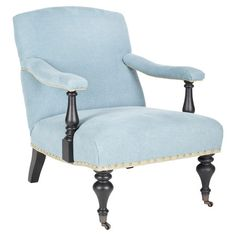 Wrapped in light blue upholstery, this nailhead-trimmed arm chair brings breezy appeal to your library or reading nook.  Product: