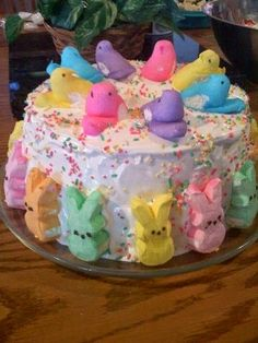 Angel food cake in a bundt pan with White frosting and pastel sprinkles, covered with Peeps recipes dessert recipes dessert brunch recipes dessert cake recipes dessert easy recipes dessert kids recipes dessert video Easter Deserts, Easter Snacks, Easter Peeps, Hoppy Easter, Easter Brunch, Easter Party, Easter Treats, Easter Recipes, Easter Food
