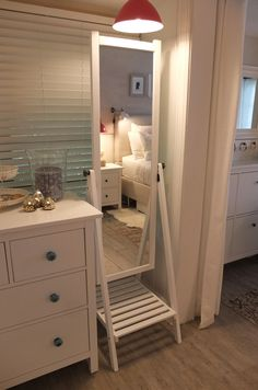 When you don't have wall space for a full-length mirror chose the IKEA ISFJORDEN standing floor mirror. It also has side knobs for hanging belts and accessories, and a shoe shelf.